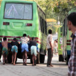 Green bus broken down on the road